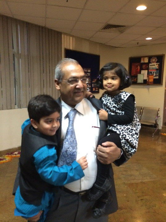 With both Grandkids. He was present for both their births!